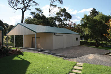 Custom designed steel garage with divided open bay by Judds Garages near the Hunter NSW