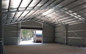 Large Fair Dinkum Sheds structure in COLORBOND Monument by Judds Garages