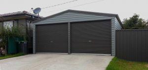 Double steel garage in horizontal M cladding with roller doors