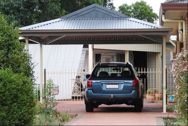 Steel carport with Dutch gable roofline in COLORBOND by Judds Garages, Edgeworth NSW