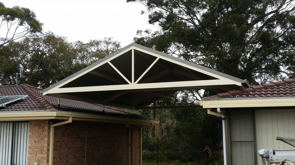 Gable flyover roof carport with decorative spokes from Judds Garages