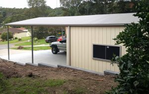 Double garage with caraport in Teralba with vertical K panel in Classic Cream