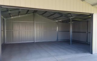 Double garage with garaport and lean-to in Argenton with vertical K panel