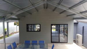 Double garage with single 5-metre roller door and rear room