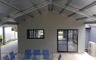 Double garage with single 5-metre roller door and rear room