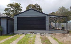 Double garage with single 5-metre roller door in horizontal M-panel cladding
