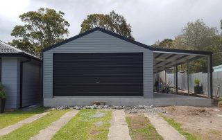 Double garage with single 5-metre roller door in horizontal M-panel cladding