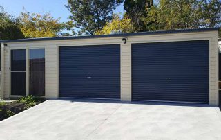 Double garage with attached games room in horizontal M panel cladding near Cardiff