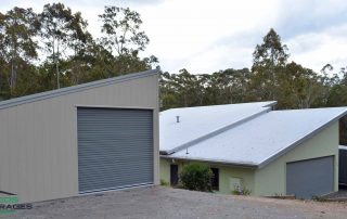 Single monopitch garage with non-standard roof pitch to match existing house, in vertical K panel cladding