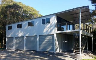 Double-story four-car garage with upstairs entertaining area by Judds Garages, garage builders in the Hunter Valley