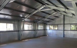 The upstairs entertaining area of a double-story four-car garage