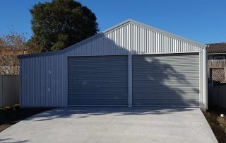 Double garage with enclosed lean-to in vertical corrugated COLORBOND near Barnsley
